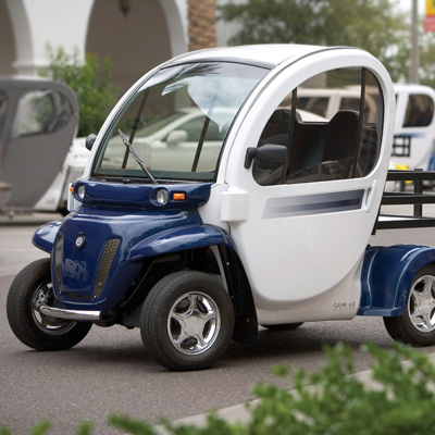 GEM<sup>&reg;</sup> e2 Electric Car - Economic and environmentally friendly, this two-passenger vehicle is ideal for the short trips you make every day. Six 12-volt flooded electrolyte batteries provide a range of up to 35 miles on a charge.